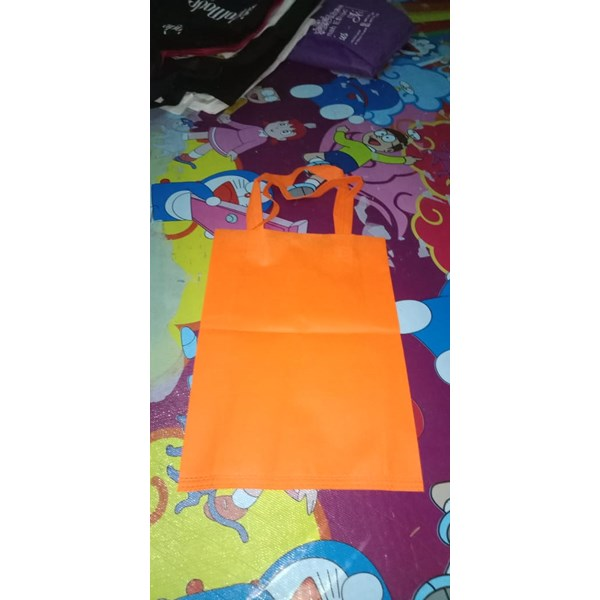 tas spunbond uk.30x40 berbentuk press tali wrna orange